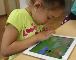 Child using an NGPM app